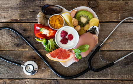 immunity building foods on heart shaped plate